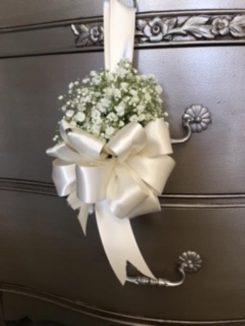 A photo of flowers for an aisle chair for a wedding by Josie's Jumble, a florist near Alexandria, Louisiana.