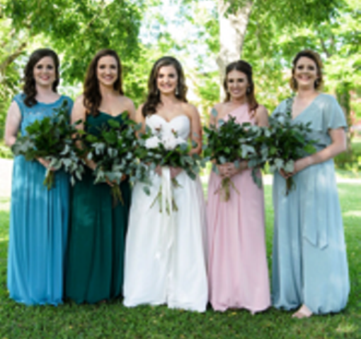 A beautiful bride and her bridesmaids with bouquets by Josie's Jumble, a florist located near Alexandria, Louisiana.