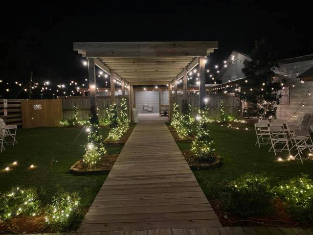The walkway decorated for an outdoor wedding at Le Barn Rouge, a wedding venue in Lafayette, Louisiana.