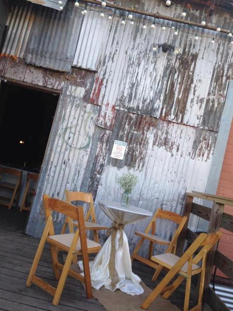 An Outdoor Porch Tables Setup At The Rustic Feed N Seed A Wedding Venue Located In Lafayette Louisiana