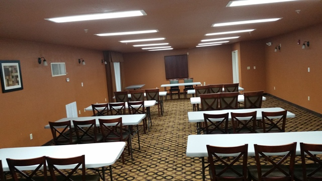 A photo of the wedding venue, Best Western Plus Vermilion River Suites, located in Lafayette, Louisiana, set up for a business meeting.