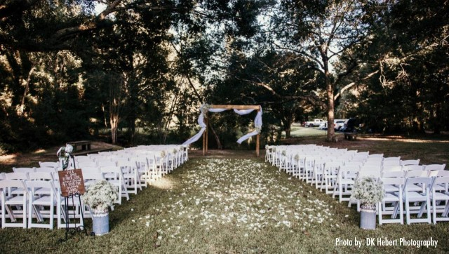 An outdoor wedding setup at the wedding venue, Woodlawn Chapel, located near Lafayette, Louisiana.