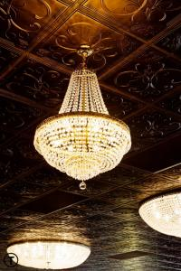 An amazing chandelier hanging from the ceiling at the wedding venue Reeves Uptown Catering in Lake Charles, Lousiana.