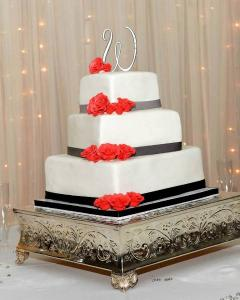 A black and white wedding cake made by Piece of Cake, located near Lafayette, Louisiana.