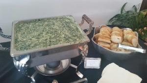 A wedding catering company, Bon Temps Grill, located near Lafayette, Louisiana, showing a large container of their wonderful Spinish Dip.