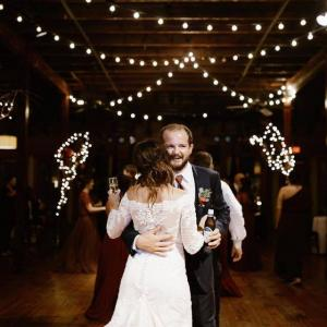 A bride and groom dancing at the wedding venue called The Crossing at Mervin Kahn located near Lafayette, Louisiana in Rayne.
