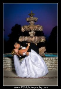 A bride and groom kissing at the beautiful wedding venue, The Manor, located in New Iberia, Louisiana.