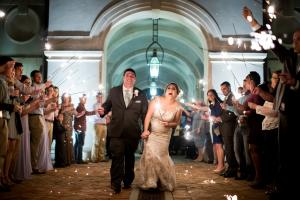 The bride and groom leaving the wedding venue, The Majestic Hall at Walnut Grove, located in Lake Charles, Louisiana.