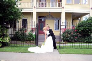 The bride and groom in front of Esprit de Coeur venue near lafayette louisiana