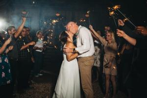 A bride and groom send off with sparklers at the unique wedding venue Cypress Grove located near Lafayette, Louisiana in Eunice.