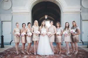 The bride and her wedding party in front of the wedding venue, The Majestic Hall of Walnut Grove located in Lake Charles, Louisiana.