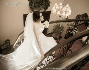 A beautiful bride gliding up the stairs at the wonderful wedding venue, The Manor, located near Lafayette, Louisiana.