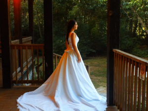 A bride on the steps at the wedding venue located near Lafayette, Louisiana, Woodlawn Chapel.