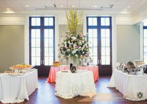 The catering tables setup for a wedding reception at the wedding venue, The Majestic Hall of Walnut Grove located in Lake Charles, Louisiana.