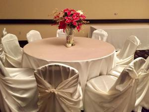 A centerpiece and table setup for a wedding reception at Hampton Inn wedding venue located in New Iberia, Louisiana.