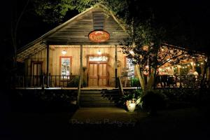 Cypress Grove Wedding Venue showing a unique front night view lit up, which is located in Eunice, Louisiana near Lafayette, Louisiana.