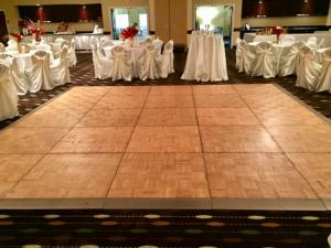 A dance floor with tables setup for a wedding reception at wedding venue Hampton Inn New Iberia, Louisiana.