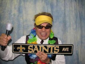A New Orleans Saints fan taking a photo at Digital Music Services Photo Booth located near Lafayette, Louisiana.
