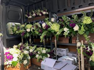 Florist Mai Nguyen with Faith and Flowers located near Lafayette, Louisiana with her truck loaded up for her next event.