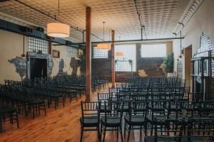 An indoor wedding setup at The Crossing of Mervin Kahn, a wedding venue near Lafayette, Louisiana in Rayne.
