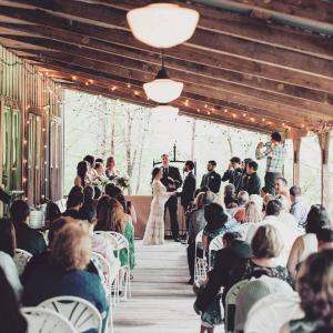 A wonderful photo of a bride and groom getting married outdoor at the wedding venue Cypress Grove in Eunice, Louisiana near Lafayette, Louisiana.