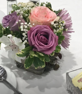 A wedding reception centerpiece made by Lafayette, Louisiana florist, Posies by Paulie.
