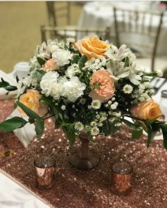 A wedding table centerpiece for a wedding reception by Lafayette, Louisiana wedding florist, Poises by Paulie.