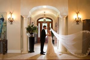 A bride and groom in the great room of a wedding venue near Lafayette, Louisiana Cajun Mansions.