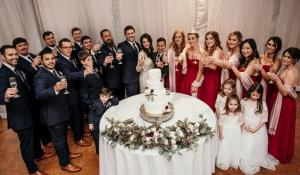 A beautiful photo of the bride and groom with their wedding party by wedding photographer, DK Hebert Photography, located near Lafayette, Louisiana.