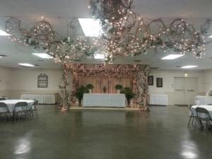 Located near Lafayette, Louisiana the ladybug lodge decorated for an indoor wedding