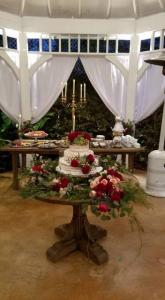 A beautiful wedding cake setup by Louisiana Wedding Venue Near Lafayette The Victorian Plantation in Broussard, Louisiana.