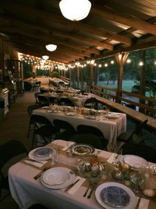 Amazing outdoor wedding reception setup on the decking at Cypress Grove Wedding Venue in Eunice Louisiana.