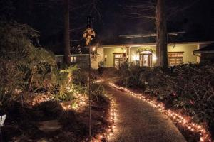 A beautiful night time view with lights of the wedding venue Louisiana Cajun Mansions located in Youngsville, Louisiana near Lafayette.