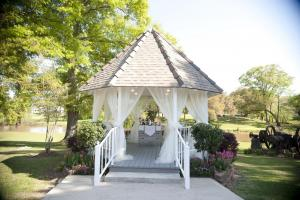 Awesome outdoor white wedding gazebo on the wedding venue property of Poche Bridge Country Club near lafayette louisiana