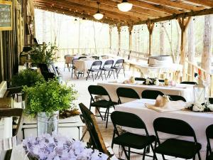 Amazing outdoor wedding reception setup on the decking at Cypress Grove Wedding Venue in Eunice Louisiana