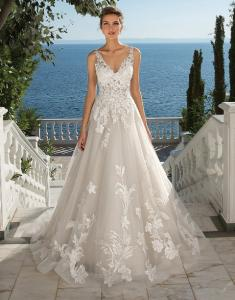 A beautiful bridal dress with lace from bridal boutiques, Sposa Bella, located in Lafayette, Louisiana.