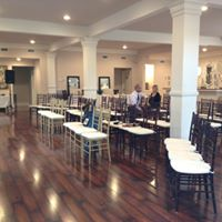 The tables are setup for a business meeting at venue Esprit de Coeur located near Lafayette, Louisiana.