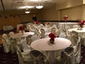 Tables are setup for a wedding reception at wedding venue Hampton Inn located in New Iberia, Louisiana.