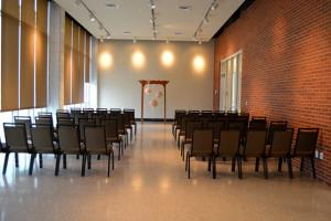 A setup for an indoor business event at UL Lafayette Event Spaces in Lafayette, Louisiana.