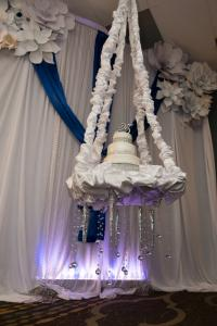 A unique 25th anniversary cake suspended from the ceiling at the wedding venue, The Wyndham Gardens of Lafayette, Louisiana.