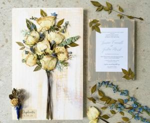 A wedding bridal bouquet and wedding invitation preserved by a wedding vendor located in Lafayette, Louisiana, Petal Press Decor.