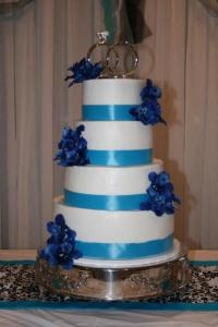 A blue and white wedding cake made by Piece of Cake, a bakery located in Lafayette, Louisiana.