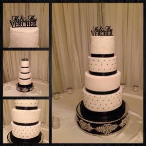 An elegant wedding cake in white and black made by Piece of Cake, a bakery located near Lafayette, LA.