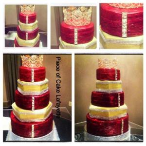 A wedding cake in red and yellow made by Piece of Cake, a bakery located near Lafayette, Louisiana.
