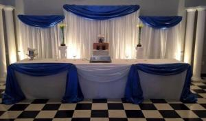 A wedding reception table setup by wedding decorator, Fleur de Lis, located in Lafayette, Louisiana.
