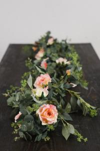 A beautiful Spiral Seeded Eucalyptus Garland Pink Single Stem by wedding florist, Something Borrowed Blooms, located near Lafayette, Louisiana.