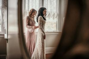 The bride with her mother in front of a mirror by wedding photographer, DK Hebert Photography, located near Lafayette, Louisiana.