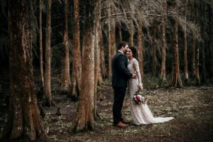 The bride and groom among the trees by wedding photographer, DK Hebery Photography, a wedding photgrapher near Lafayette, Louisiana.