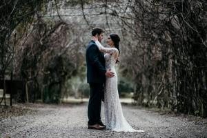 A beautiful photo of a bride and groom under an archway by wedding photographer, DK Hebert Photography, located near Lafayette, Louisiana.