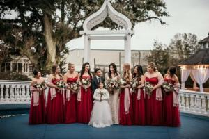 The bride and groom with the bridesmaids by wedding photographer, DK Hebert Photography, located near Lafayette, LA.